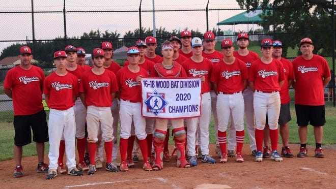 Coaches and players of the victorious Waynesboro 19U baseball team take time for a team picture after winning the Frederick Wood Bats League playoff championship, Monday in Frederick. Pictured are, front row (left to right): Nathan Wynkoop, Sam Moore, Ben Wolff, Owen McCleaf, Garrett Beaver, Izzy Reed and Garrett Blount. Second row: Justin Biser (coach), Aaron King, Troy Witte (coach), Josh Clapsaddle, Kurt Biesecker, Jared Peck, Hunter Clever, Bryce Shaffer, Fred Guarino, Wyatt Freeman, Jody Blount (coach) and Dan McCleaf (manager). Missing from photo: Derek Buhrman, Ryan McCleaf, Cole Stouffer, Luke Martin and Aiden Campbell.