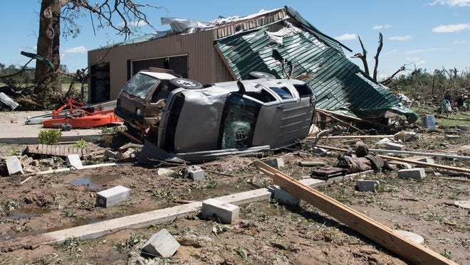 An overturned vehicle rests on the ground surrounded by debris in Canton, Texas, on April 30, 2017, after tornadoes hit the area.