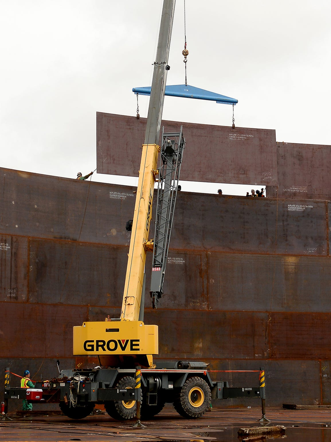 A Crane Lifts Up A Steel Plate And Workers Maneuver Enbridge Sidesteps  Zoning For Stockbridge Tank