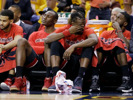 Toronto Raptors sit on the bench during a 115-84 loss to the Cleveland Cavaliers in Game 1 of the NBA basketball Eastern Conference finals, Tuesday, May 17, 2016, in Cleveland. (AP Photo/Tony Dejak)