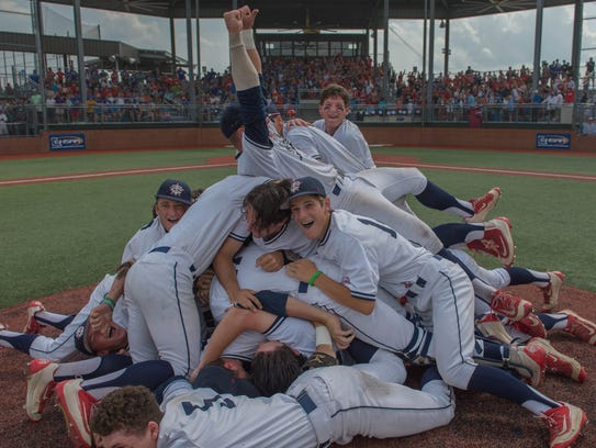 Teurlings Catholic Rebels celebrate on the mound after