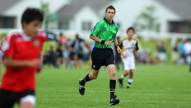 Referee Michael Przybylski of Chicago works the U14 match between Cincinnati United Premier and Ace Milwaukee at the US Youth Soccer Region II Championships on Saturday at Scheels USA Youth Sports Complex in Appleton.