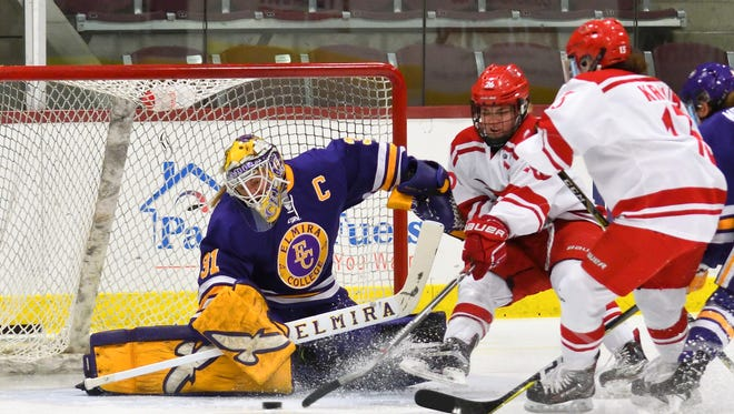 Elmira College goalie Kelcey Crawford makes a save against Plattsburgh earlier this season.