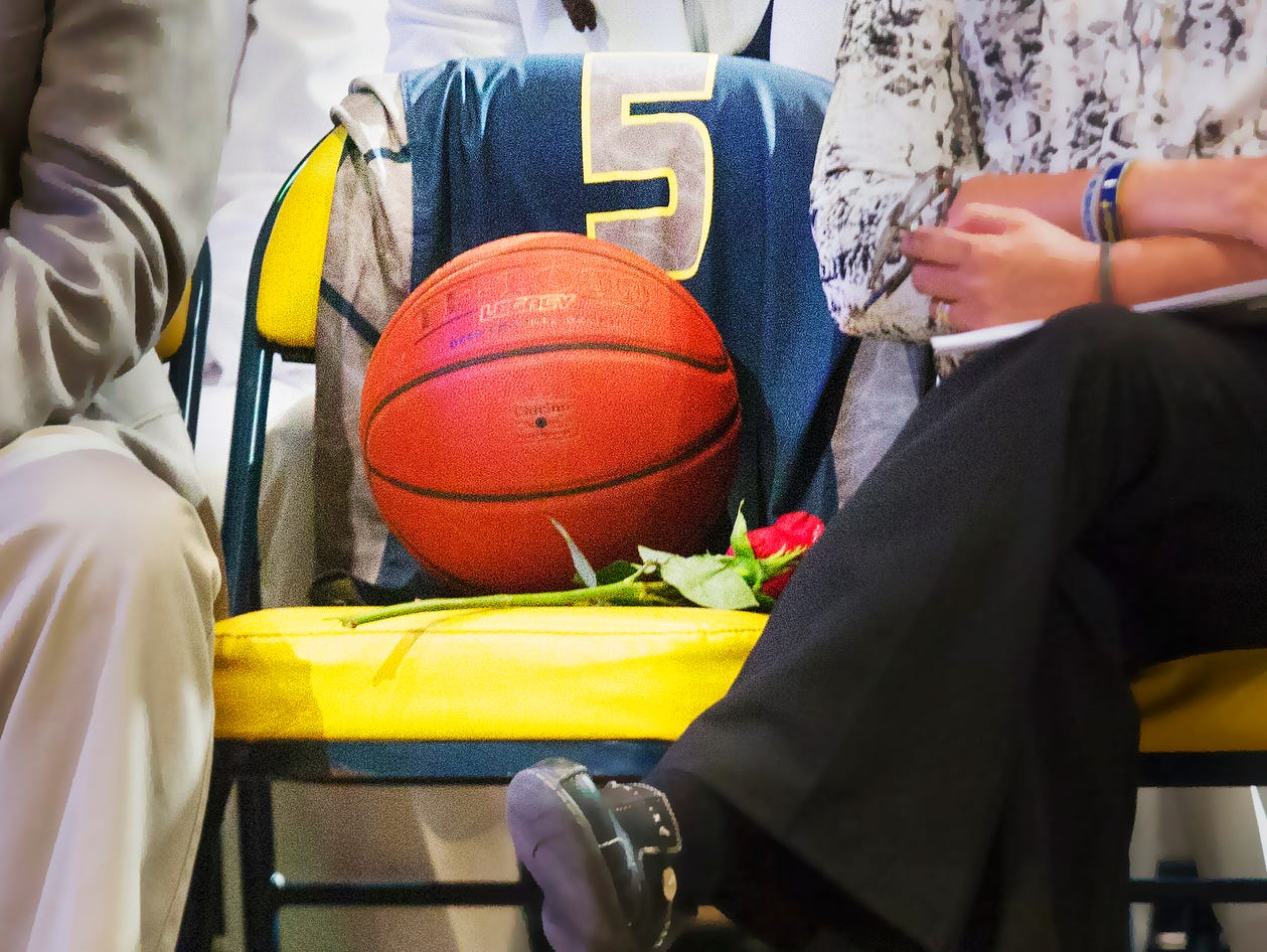 Stef'An Strawder's jersey drapes a seat of remembrance Saturday during his funeral at New Life Assembly of God in Lehigh Acres. Strawder was killed recently in the Club Blu nightclub shooting in Fort Myers.