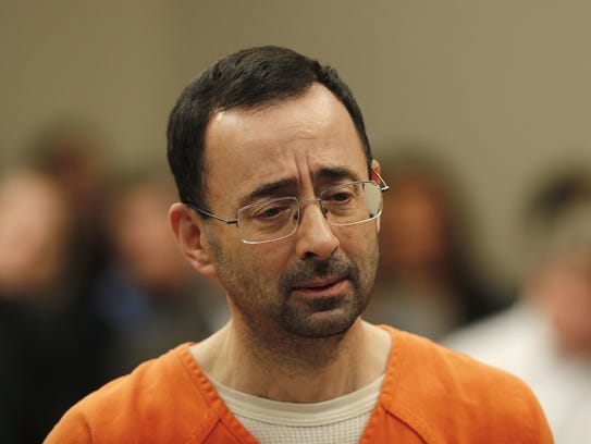 Larry Nassar, 54, appeared in court for a plea hearing in Lansing, Mich., on Nov. 22, 2017. Nasser, a former sports doctor, was sentenced to prison after pleading guilty to multiple charges of criminal sexual assault.