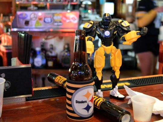 Steelers memorabilia decorate the bar at Buxy's Salty Dog Saloon in Ocean City.