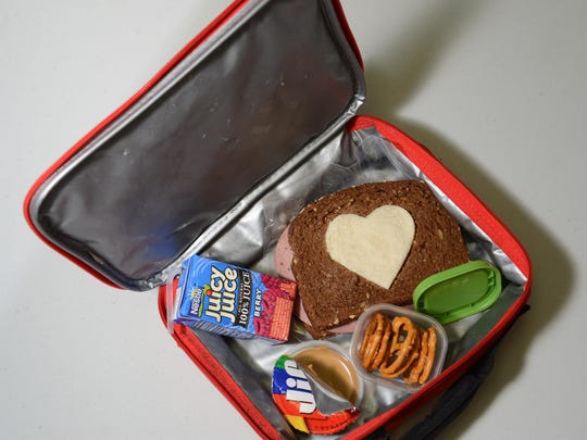 Kid-friendly food items are packed into a lunch box.