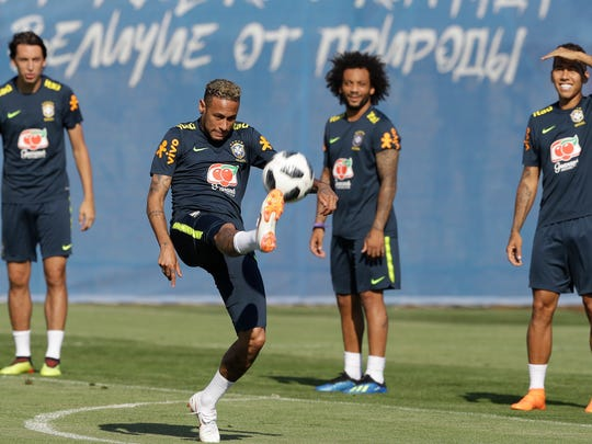 Brazil's Neymar, center practices with teammates during a training session, in Sochi, Russia, Sunday, June 24, 2018. Brazil will face Serbia on June 27 in the group E for the soccer World Cup. (AP Photo/Andre Penner)