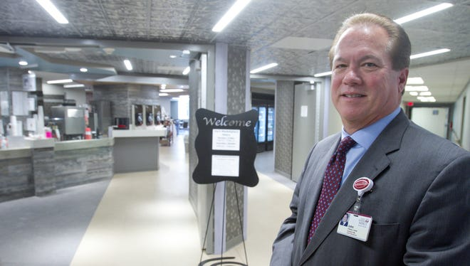 """John O'Malley, standing in front of the Howell hospital's newly renovated """"Joe's Java"""" coffee shop, has taken the reins as president of Saint Joseph Mercy Livingston Hospital and Saint Joseph Mercy Brighton Hospital."""