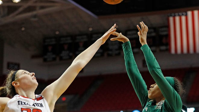 Baylor's Juicy Landrum (20) shoots the ball over Texas Tech's Brittany Brewer (20) during the second half of an NCAA college basketball game Saturday, Feb. 3, 2018, in Lubbock, Texas.