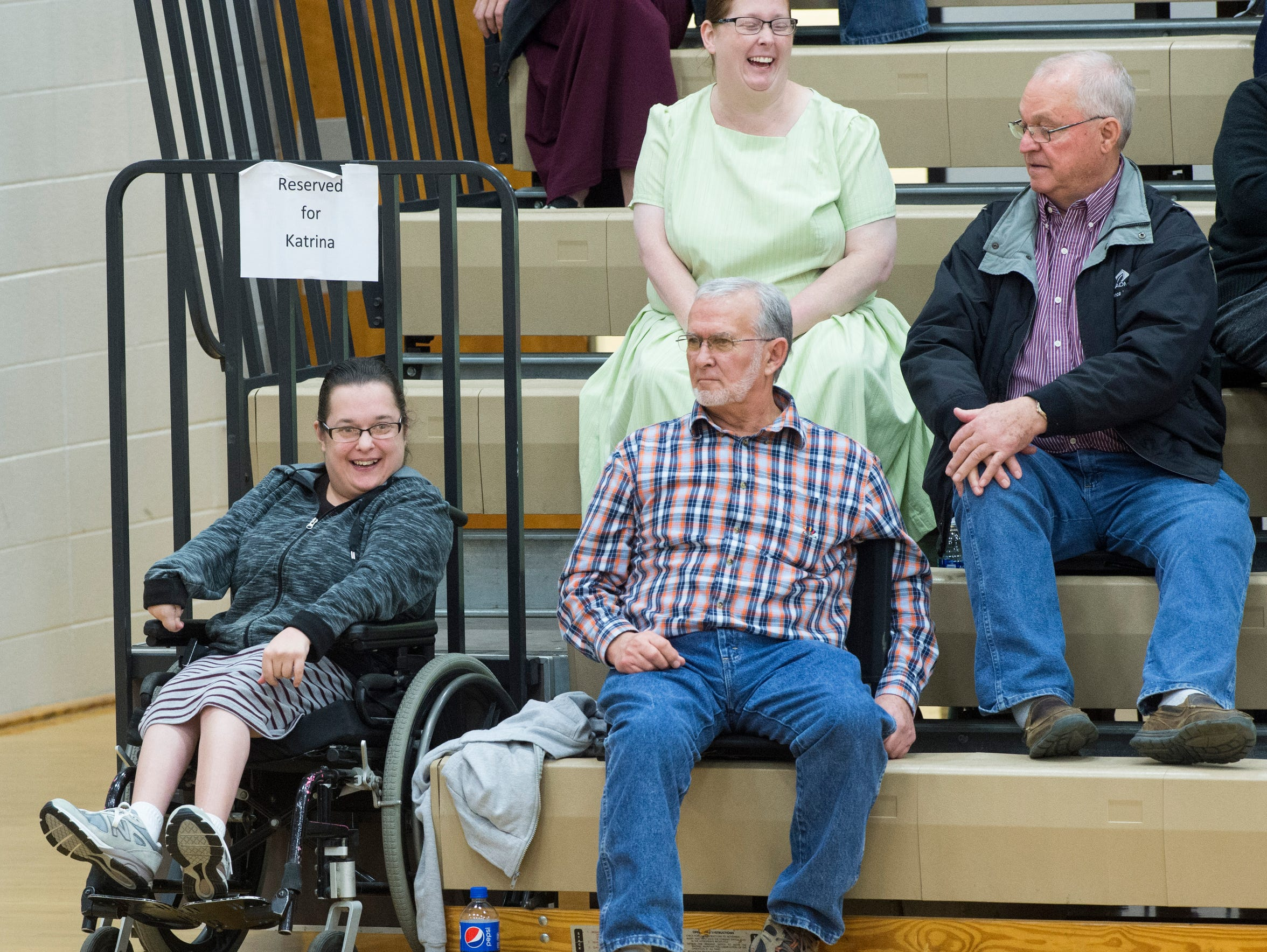 Katrina Wagler, left and her dad Marvin enjoy the game from their reserved seats at North Daviess High School on Friday, Feb. 16, 2018. North Daviess defeated White River Valley 38-23.