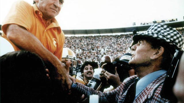 Tennessee players carry Coach Johnny Majors, left, on their shoulders to shake hands with Alabama's Bear Bryant at midfield after their 1982 victory in Neyland Stadium.
