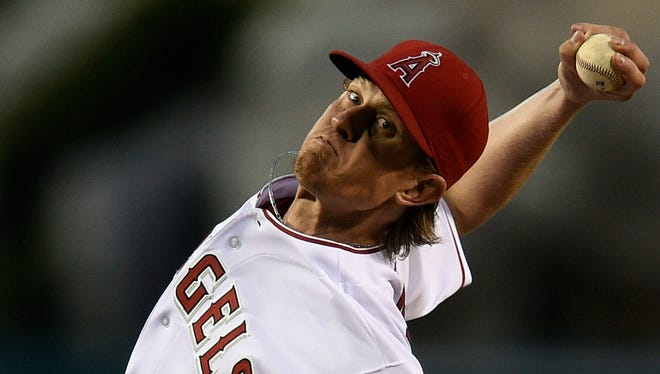 """Jered Weaver, 31, might not be able to throw as hard, but he has figured out other ways to get outs. """"I'm not 23 anymore, but getting a feel for the hitters ... I think I've been pretty good at that."""""""