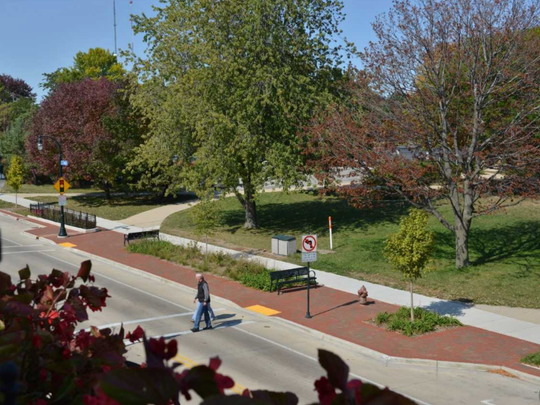 Decorative bumpouts with trees and grasses are proposed to beautify National Avenue. The bumpouts also make crossing streets safer because traffic tends to slow down when the road narrows.