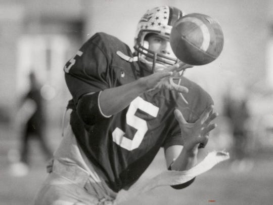 NOVEMBER 10, 1988: Jeff Bond catches a pass in a Harrison