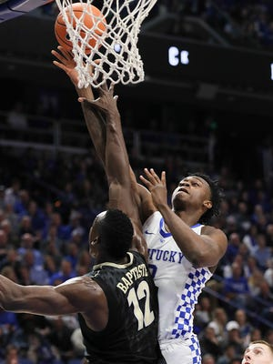 Kentucky's Jarred Vanderbilt goes up against Vanderbilt's Djery Baptiste in the first half.