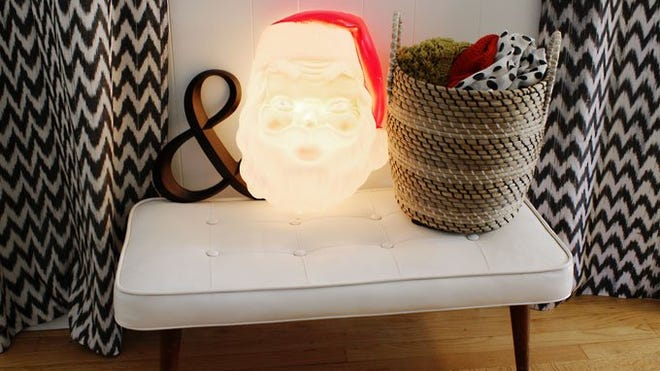 Decorations in home of Tracey Tilley of Madison Heights include her favorite bargain, a $10 light-up Santa purchased at a Goodwill store.