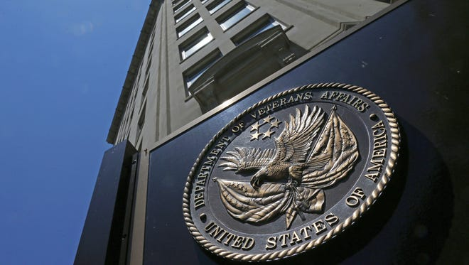 In this June 21, 2013, file photo, the seal affixed to the Department of Veterans Affairs building in Washington is shown.