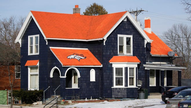 Don Kober's house, seen Thursday, on 14th Street in Sheboygan is hard to miss with its Denver Bronco football colors.