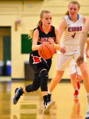 Ally Haar (left) of Lakota West dribbles the ball up court against Kings.