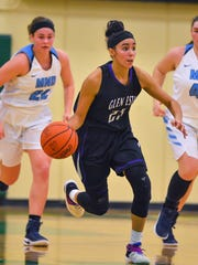 Jasmine Hale of Glen Este dribbles the ball up court