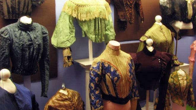 A gallery case full of fashionable waists from the 19th century, at the Centerville Historical Museum.