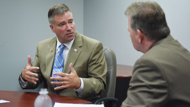 Rep. Chris Gibson, left, speaks with John Penney, right, of the Poughkeepsie Journal.