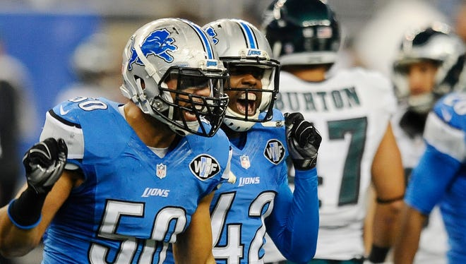 Lions Travis Lewis and Isa Abdul-Quddus celebrate after Eagles kicker Caleb Sturgis misses a field goal in the first quarter.