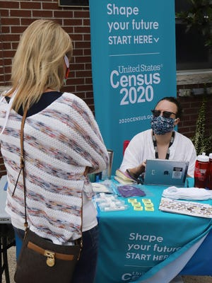 Census taker Elizabeth Miller, right, helps Rhonda Nunley fill out her family's Census 2020 forms, Saturday, Sept. 12, at a booth set up on Van Buren's Main Street.