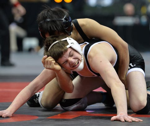 Annandale/Maple Lake's Holden Youngs (right) wrestles Worthington's Hser Eh Pwae in the Class 2A Minnesota State Individual Wrestling Tournament quarterfinal 106 pound match Friday at the Xcel Energy Center in St. Paul. Young fell to Pwae 8-6 in overtime.