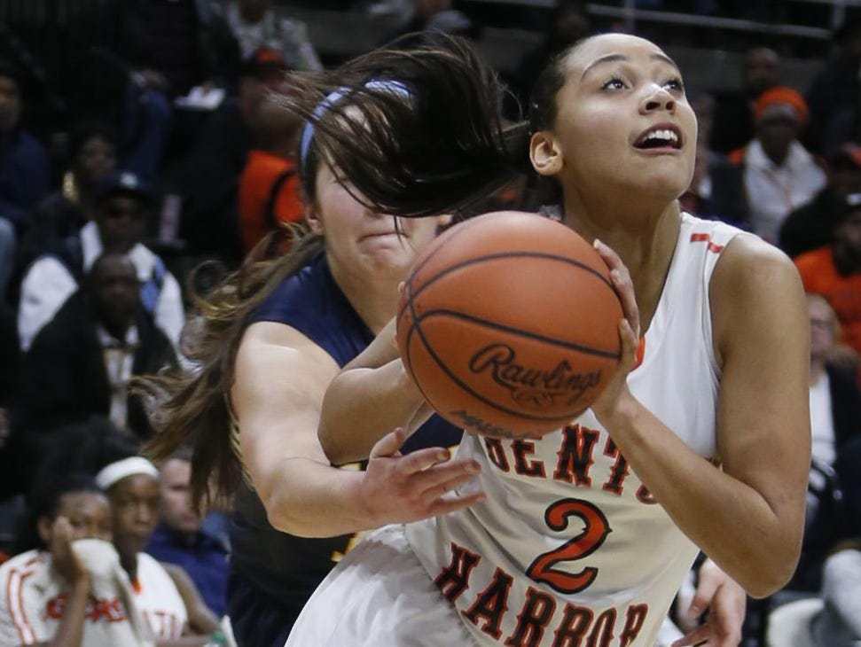 As a junior, Kysre Gondrezick averaged 25.7 points, 10.3 rebounds, 5.6 assists and 3.6 steals and led Benton Harbor to the Class B state semifinals with her sister Kalabrya.
