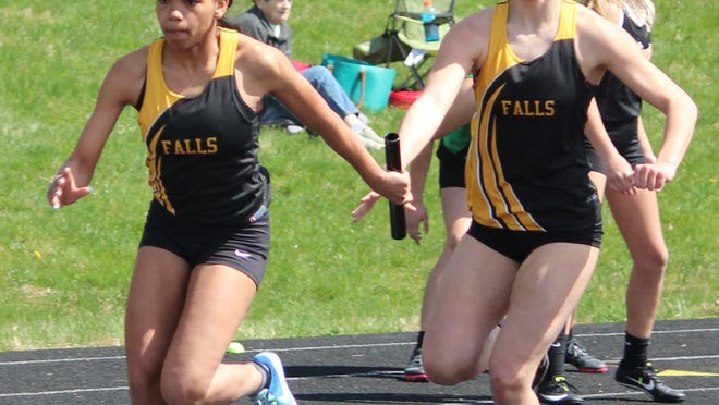 Cuyahoga Falls' Aiamyia Dudley gets the baton from teammate Emma Brustoski during the Big Ox Invitational in 2019.