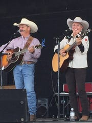 Gary and Jean Prescott perform as a part of the Cowboy