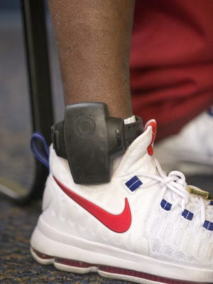 A locked-in monitor, shown on the ankle here, are serviced by the Indy office of Track Group, which specializes in distributing and collecting data on GPS ankle monitors given to criminal offenders.