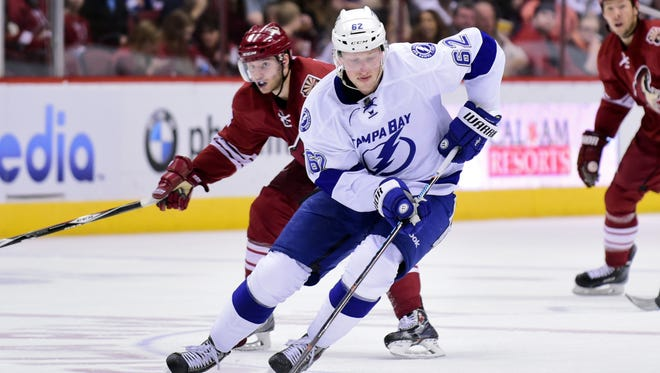 Feb 21, 2015: Tampa Bay Lightning defenseman Andrej Sustr (62) carries the puck as Arizona Coyotes center Tobias Rieder (8) pursues during the second period at Gila River Arena.