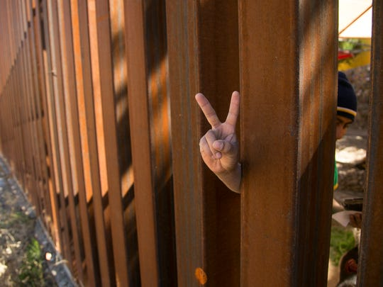 Freddy Perez, 26, flashes the peace sign through the