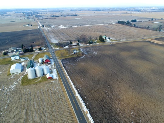 Thomas Fliess Sr., whose home and farm buildings are on the left in the photograph, last week was paid $18 million for 380 acres of farmland he sold for the Foxconn project.