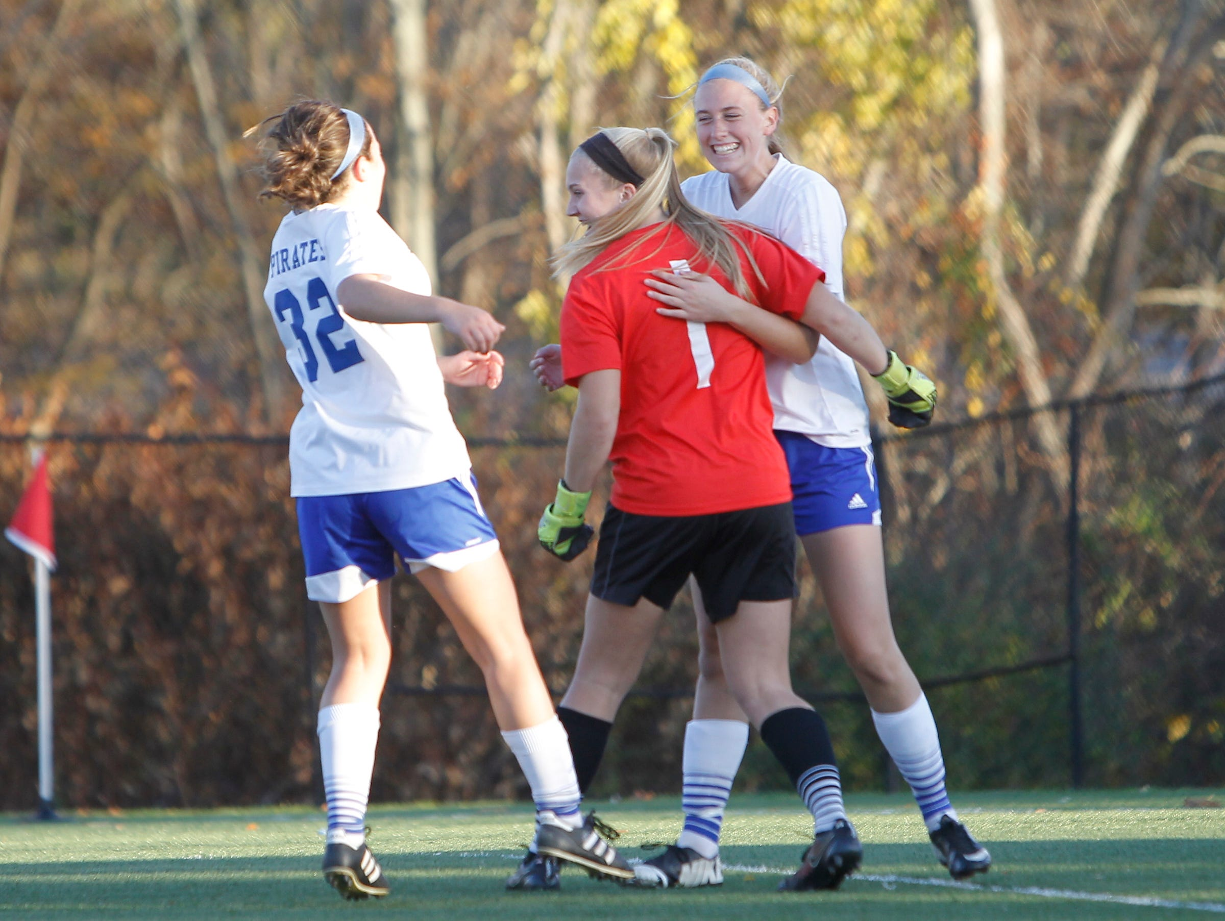 Pearl River's Kristen Ferriello (32), goalie Lauren Gallagher (1) and Kari Portington (22) back, celebrate their 2-0 win over Byram Hills in a sectional semi-final girls soccer game in Orangeburg on Thursday, Oct. 29, 2015.