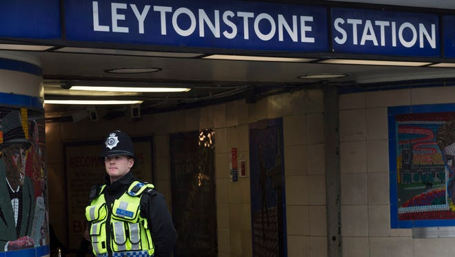 A London police officer stands outside the Leytonstone Underground station  Dec. 6, 2015.