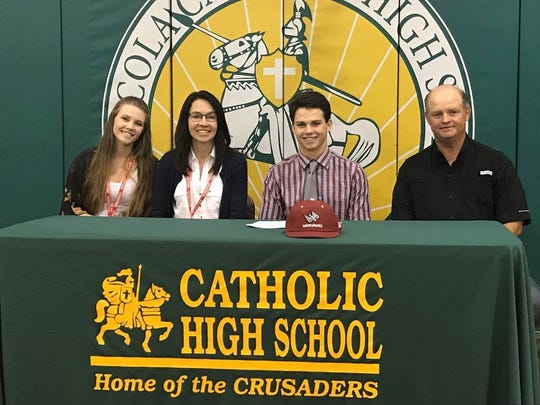 Catholic High baseball player Cole Moore, joined by his parents and sister recently signed with Coastal Alabama East Community College to play baseball.