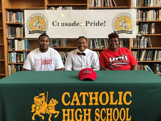 Joined by his parents, Catholic High football player Jaylen Fortune signed to play football at Kentucky Christian University.