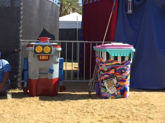 Recycling bins designed by artists are one of several projects organized by nonprofit Global Inheritance, aiming to make festivalgoers think about sustainability.