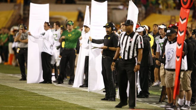Former Oregon coach Mark Helfrich was so concerned about ASU stealing Oregon's signals, he had staffers work on ways to block side views from the sidelines.
