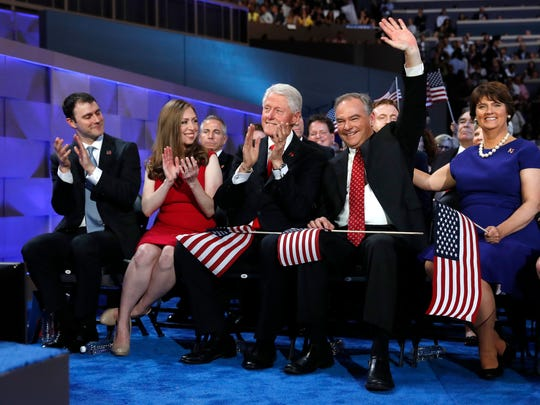 Democratic vice presidential candidate, Sen. Tim Kaine, D-Va., second from right, introduced by Democratic presidential nominee Hillary Clinton waves as Marc Mezvinsky, left, his wife Chelsea Clinton, Former President Bill Clinton and and Kaine's wife Anne Holton, right, applaud during the final day of the Democratic National Convention in Philadelphia, Thursday, July 28, 2016.