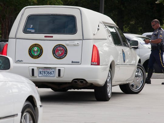 A hearse, bearing the insignia of the U.S. Army and U.S. Marine Corps, is moved into position outside the funeral of Baton Rouge Officer Matthew Gerald on Friday, July 22, 2016, in Baton Rouge.
