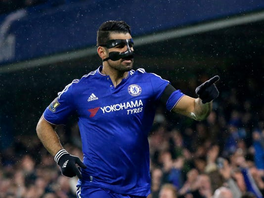 Chelsea's Diego Costa celebrates scoring his side's first goal during the English Premier League soccer match between Chelsea and Newcastle United at Stamford Bridge stadium in London, Saturday, Feb. 13, 2016.  (AP Photo/Matt Dunham)
