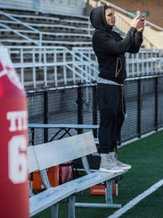 Ball State football alum Willie Snead watches the team
