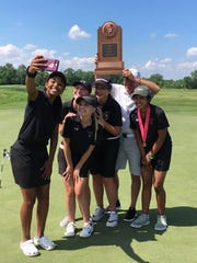 The Grinnell Tigers pose for a selfie at the Class 3A state golf tournament.