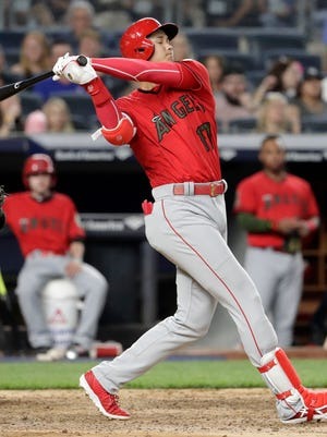 Los Angeles Angels' Shohei Ohtani strikes out against New York Yankees relief pitcher Jonathan Holder during the fifth inning of a baseball game Saturday, May 26, 2018, in New York. (AP Photo/Julio Cortez)
