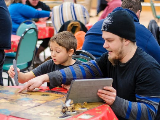 Lionheart Games owner Justin Willard teaches a young